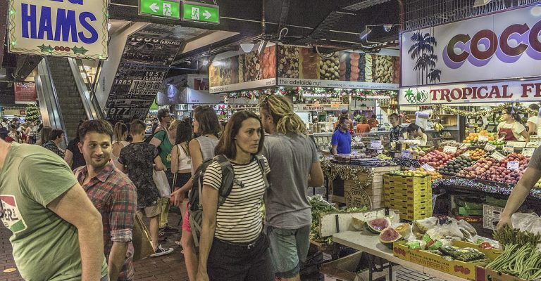 People walking through a busy indoor market